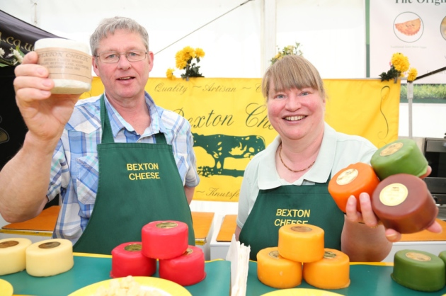 The team at Bexton Cheese pose with some mini wheels of their homemade cheese.