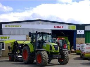 Tractor parked in front of a Rickerby building